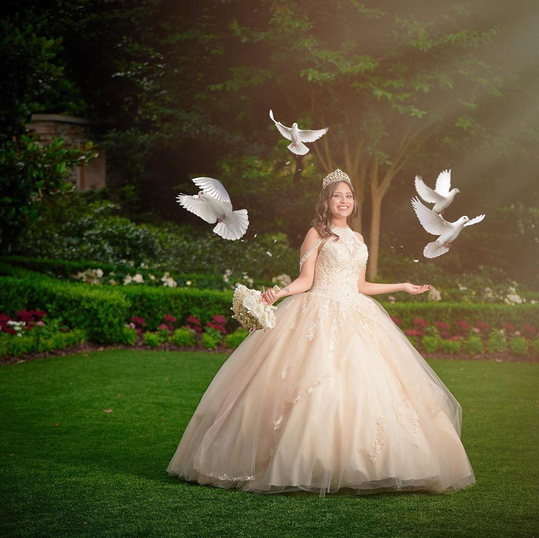 Quinceañera photo of a girl surrounded by doves