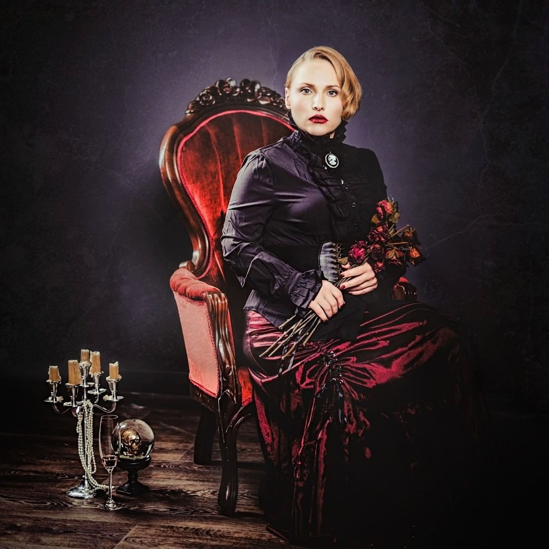 Dark mistress in a velvet chair