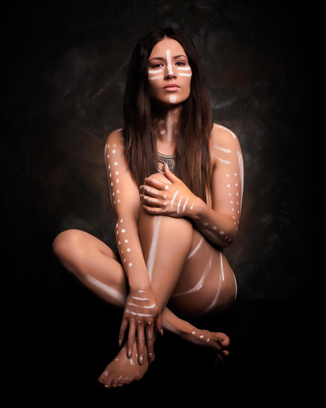 Semi nude photo of a woman in tribal paint