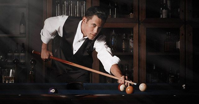 Glamour Shot of a man playing pool