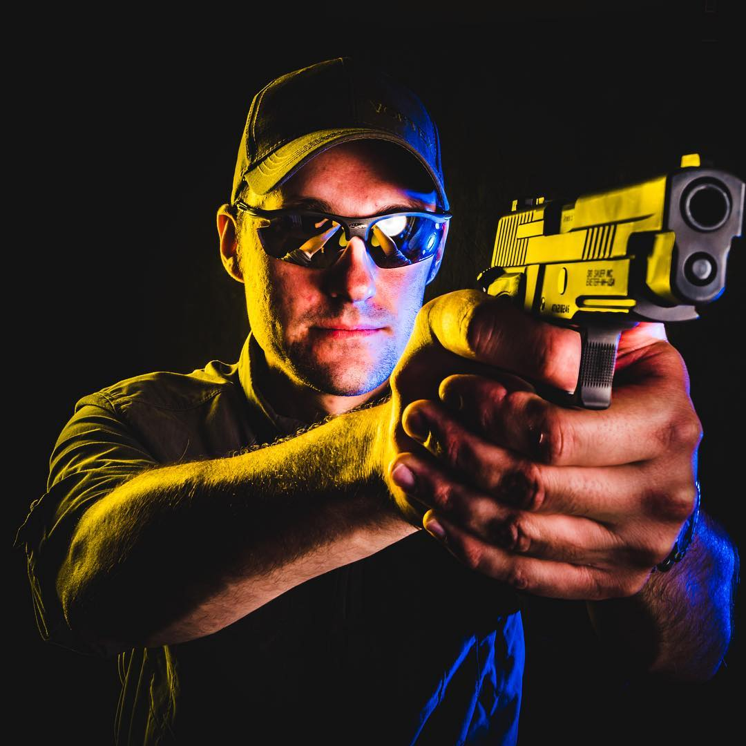Commercial shot of a gun instructor holding a pistol