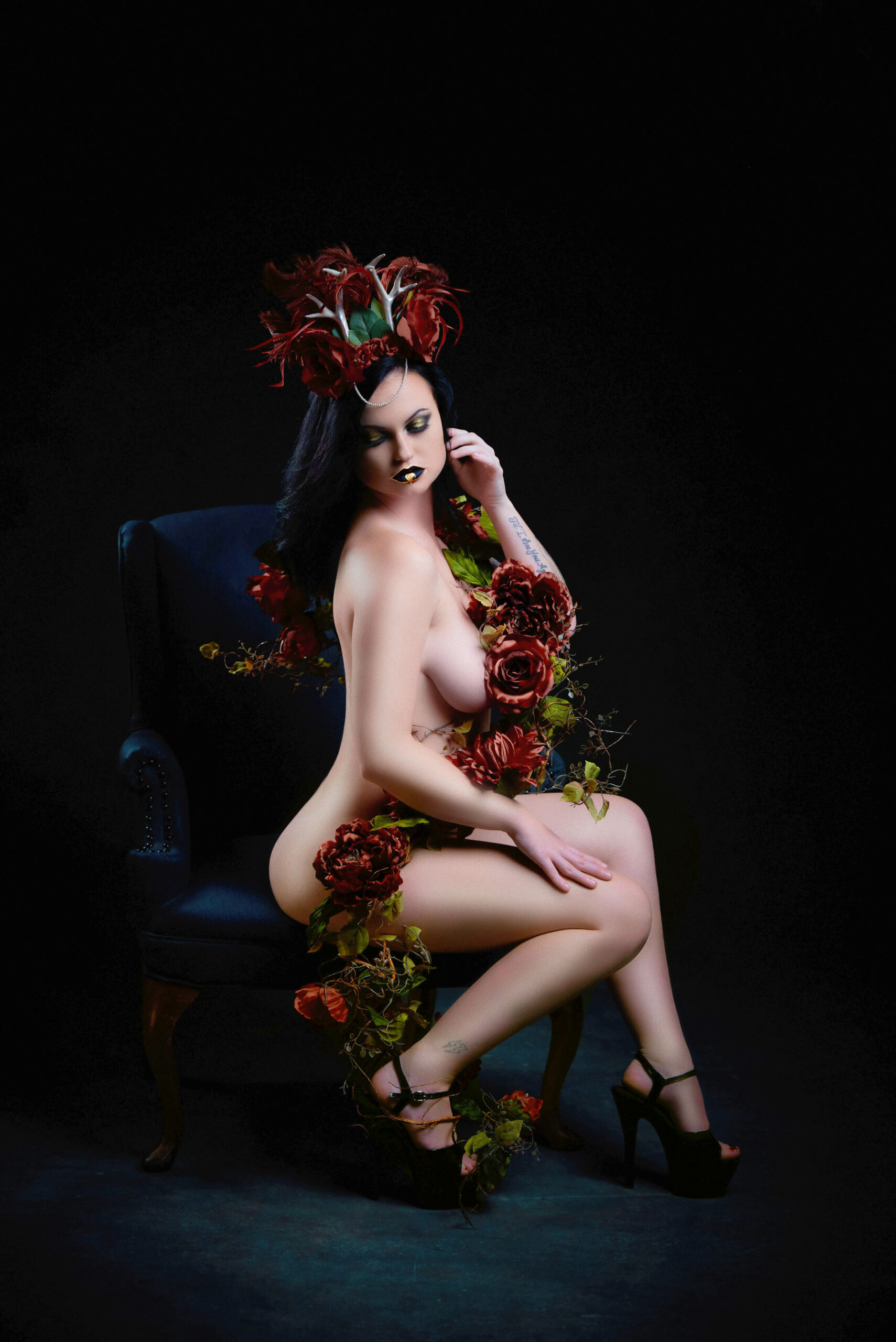 Nude Portrait of a woman shrouded in roses