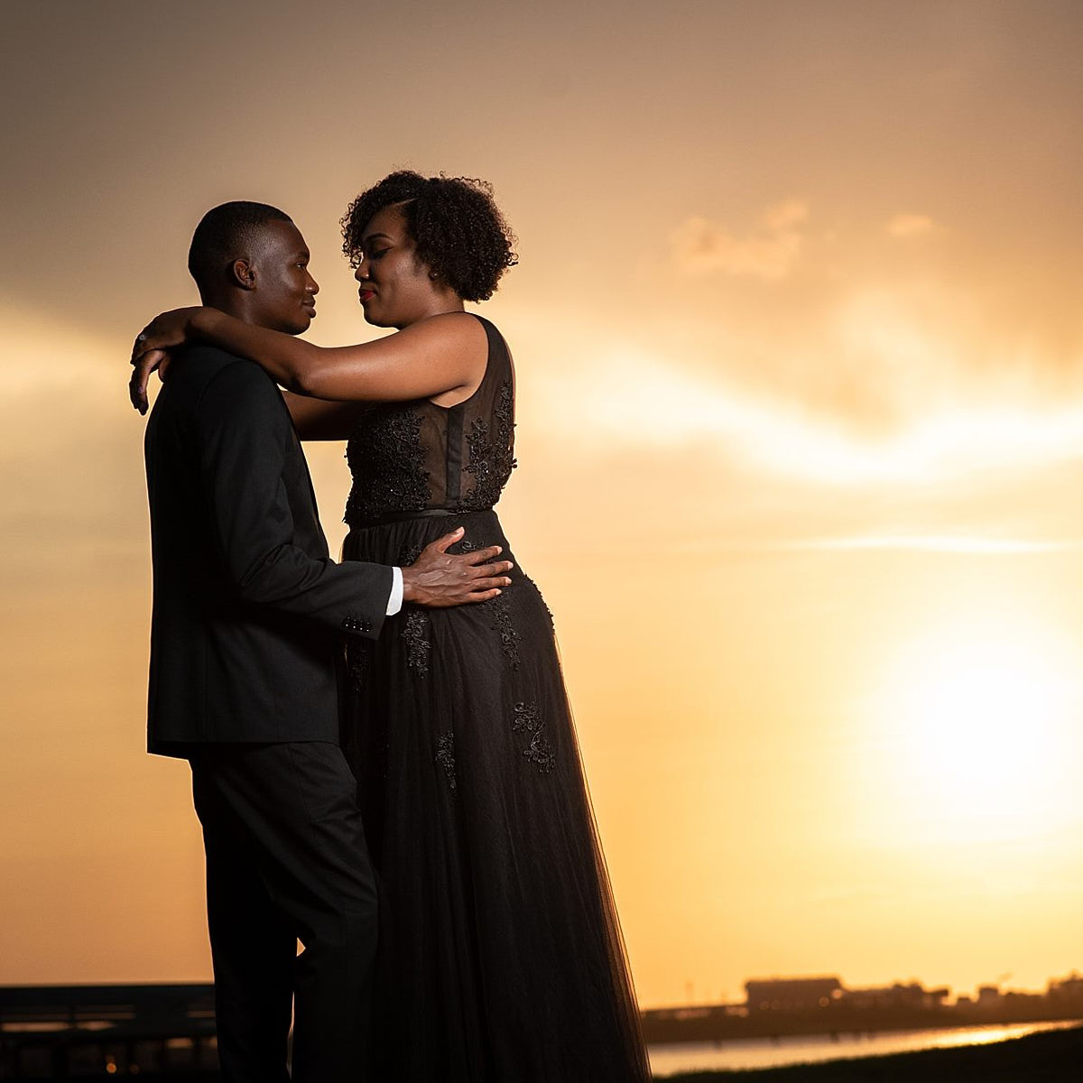 African American Couple kissing in the sunset