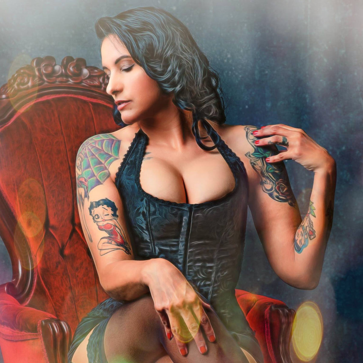 boudoir photo of a woman in a corset on a velvet chair